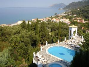 A view of the pool at Dina's Paradise or nearby