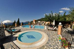 The swimming pool at or near Dina's Paradise