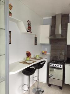 A kitchen or kitchenette at Vilaggio Montecastello II