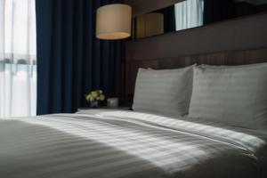 A bed or beds in a room at WESTGATE Hotel