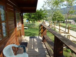 A balcony or terrace at Camping à la Ferme de Bourras