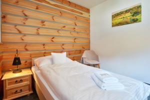 Posteľ alebo postele v izbe v ubytovaní Rezort Gothal Apartmány a Penzióny