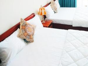 A bed or beds in a room at Tuy Hòa Beach Hotel - Căn hộ du lịch