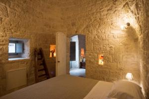 A bed or beds in a room at Le Dieci Porte