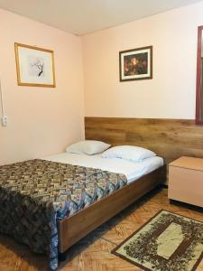 A bed or beds in a room at Energiya Holiday Home