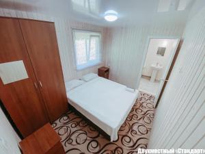 Кровать или кровати в номере База Отдыха Сосновый Бор