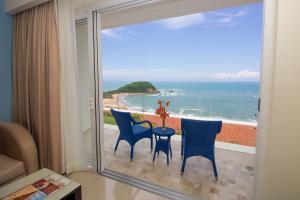 A balcony or terrace at Secrets Huatulco Resort & Spa