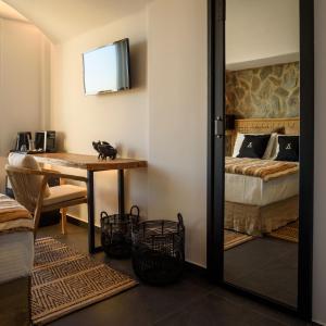 A bunk bed or bunk beds in a room at Vrachos Suites Mykonos