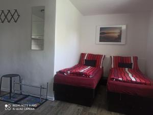 Ein Bett oder Betten in einem Zimmer der Unterkunft Penzion Wizard