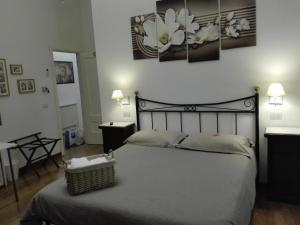 Letto o letti in una camera di Napoli Pietrasanta