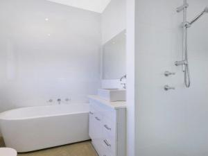 A bathroom at The Junction - contemporary meets river country
