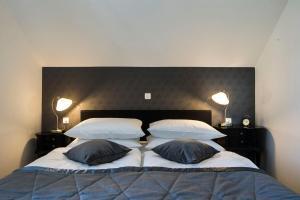 Кровать или кровати в номере Vila Mila