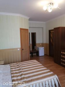 Кровать или кровати в номере Мини Отель Морской Бриз