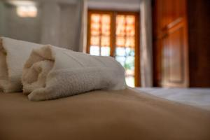 A bed or beds in a room at Pousada Campina do Monte Alegre