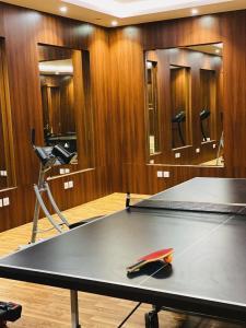 Pingue-pongue em Masharef Al Modon Hotel Suites ou nos arredores