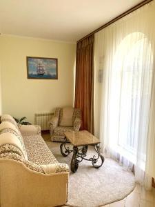 Гостиная зона в Отель Джамиля