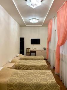 Кровать или кровати в номере Отель Джамиля