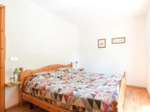 A bed or beds in a room at Spacious Chalet with Garden near Ski Area in Tyrol