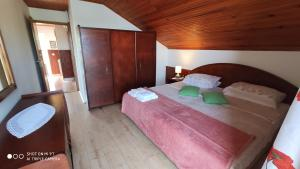 A bed or beds in a room at Apartmani Matija