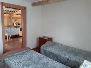 Кровать или кровати в номере Arshan Guest House