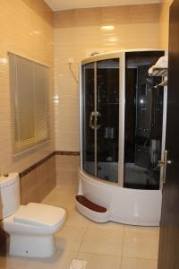 Um banheiro em Hayat Elite Hotel
