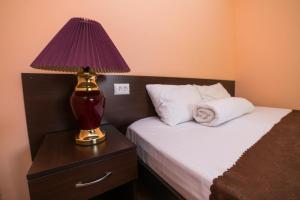 Кровать или кровати в номере  Mini-hotel Аврора house