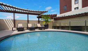 The swimming pool at or near Seda Centrio