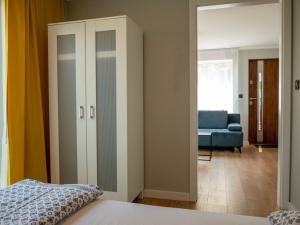 Łóżko lub łóżka w pokoju w obiekcie Hostel w ogrodzie