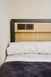 A bed or beds in a room at America Del Sur Hostel Buenos Aires