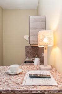 """Кухня или мини-кухня в Апарт-отель """"Hills Hotel"""""""