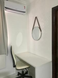 A bathroom at Studio com AR - UEM e Novo Centro