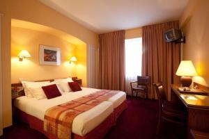 Ein Bett oder Betten in einem Zimmer der Unterkunft Hotel Imperial