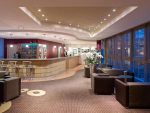 The lobby or reception area at Mercure Hotel Dortmund City