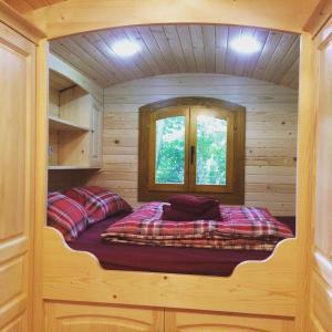 Un ou plusieurs lits dans un hébergement de l'établissement Chambres d'hôtes Au Bonheur Du Parc