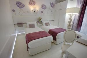 A bed or beds in a room at Eiffel Trocadéro