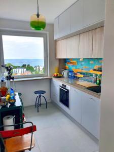 A kitchen or kitchenette at Pokoje przy plaży