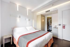 Cama ou camas em um quarto em Albergo Abruzzi