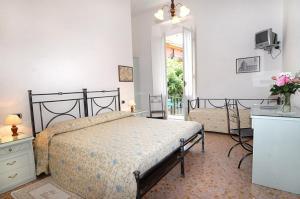 Un ou plusieurs lits dans un hébergement de l'établissement Hotel Palace