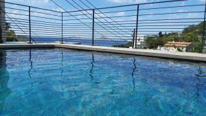 The swimming pool at or close to Suite sur la mer Marseille Corniche