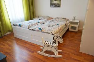 Un ou plusieurs lits dans un hébergement de l'établissement Appartements Zieglergasse