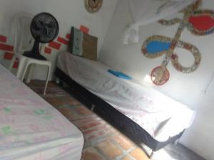 Cama ou camas em um quarto em Pousada do Melo