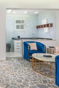 A cozinha ou cozinha compacta de الحياة إن للأجنحة الفندقيه