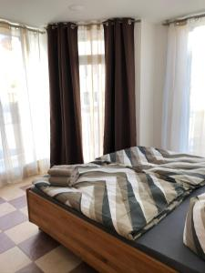 A bed or beds in a room at KL17 Ostel Döbeln