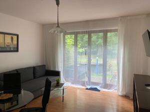 Ein Sitzbereich in der Unterkunft Ferienwohnung 1 - Gourmetzimmer