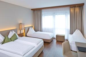 Ein Bett oder Betten in einem Zimmer der Unterkunft Hotel Penz West