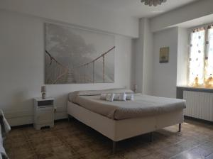 A bed or beds in a room at MONOLOCALI DA VINCI