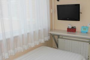 A television and/or entertainment center at Beijing Sicily Hotel