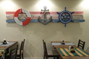 Um restaurante ou outro lugar para comer em Costa Dourada Pousada