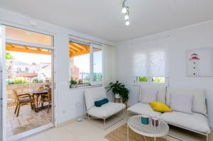 A seating area at Adriatic Sunny Apartments