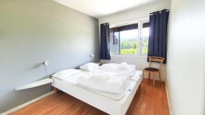 A bed or beds in a room at Geilolia Ferieleiligheter